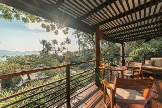Relax on the balcony of the villa in close proximity to the sea, listen to the sound of gentle waves, and enjoy the sunny days surrounded by the beauty of nature.  Missing this island paradise? Get in touch with us, we'd love to help you plan a trip!  #WellnessSanctuary #RediscoverSamui #SamuiPlus #Island #kohsamui #SunnyDay #beachvibes
